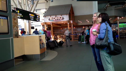 Woman checking the flight information inside airpo Footage