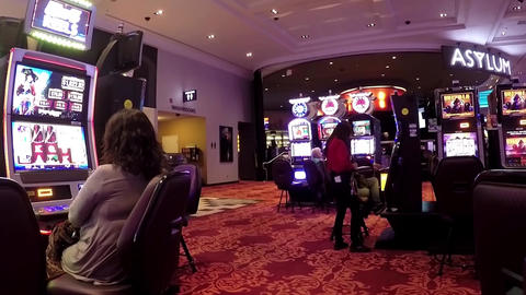 Close Up People Playing Machine Inside Hard Rock C stock footage
