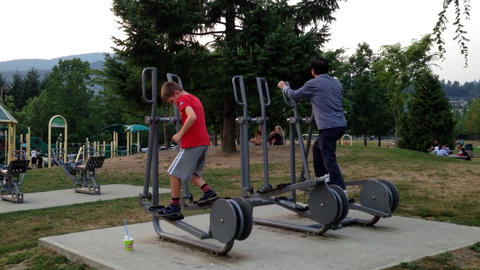People Exercising In The Park stock footage