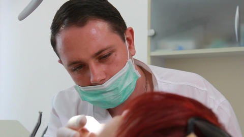 Therapeutic dentistry - Dentist in the work (on dolly, medium shot) Live Action