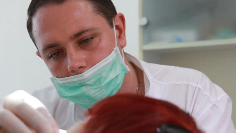 Stomatology - Dentist in the work (dolly shot, close up) Footage