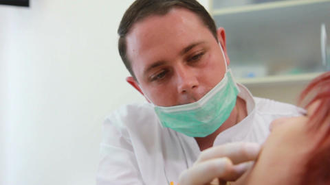 Stomatology - the dentist makes impression the jaw of the patient Footage