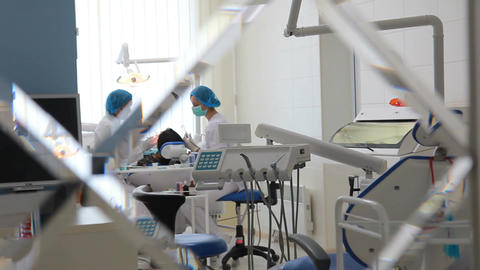 Dental surgery during operation of doctors (shot from consulting room on dolly) Live Action