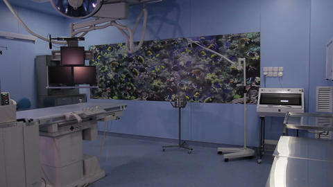 Long shot of the operating room with angiographic scanner (no people) Footage