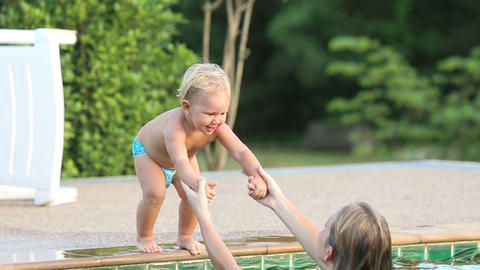 Mom And Daughter Play In The Pool stock footage
