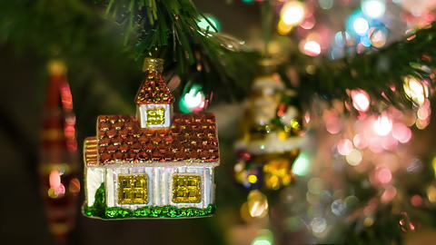 House toy on the New Year Tree with Santa on bg Footage