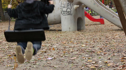 Boy Swings at Playground Footage