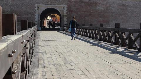Girl Walking on Old Bridge Footage