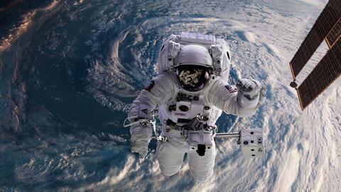 Astronaut in space with Earth, hurricane behind Footage