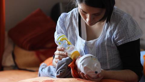 Mother Bottlefeeding Baby Footage
