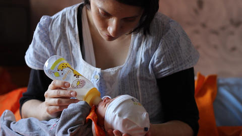 Mother Feeds Her New Born Footage