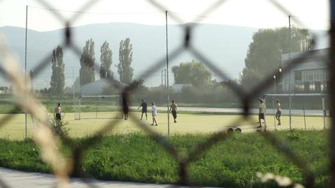 Playing Football In Neighborhood stock footage