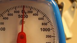 Weighing 100g Footage