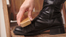 Woman Brushing Her Black Boot Live Action