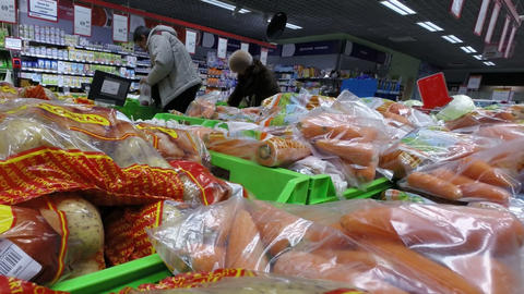 Close-up potatoes and carrots in bags on the count Stock Video Footage