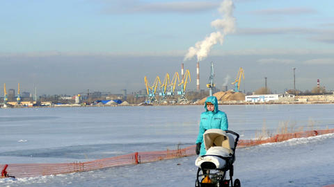 Girl with a stroller on the background of industri Stock Video Footage