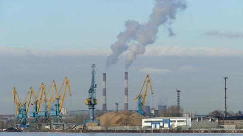 Industrial landscape - cranes, pipe smoke, winter Stock Video Footage