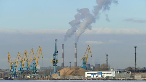 Industrial landscape - cranes, pipe smoke, winter  Footage
