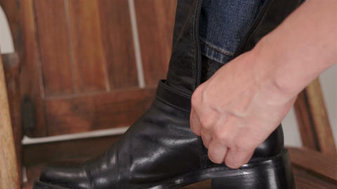 Woman Closing Her Black Boot Zipper Stock Video Footage