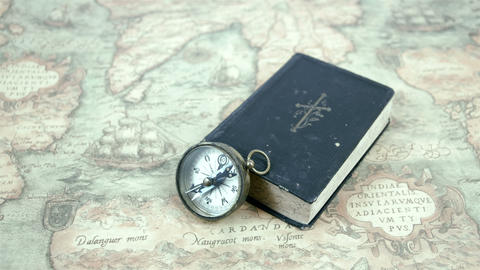 A compass and a book on a map Footage