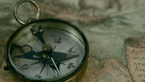 The compass lying on the map Stock Video Footage