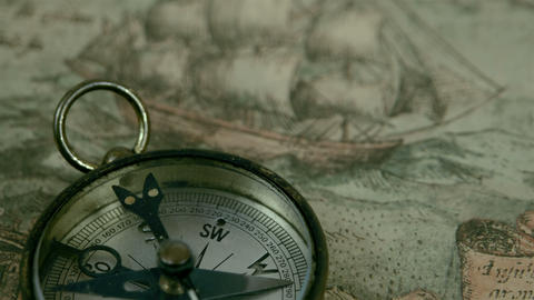 The compass lying on the map Footage