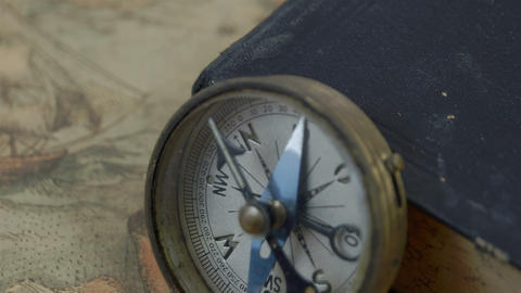 Zoom out view of the compass with the book Stock Video Footage