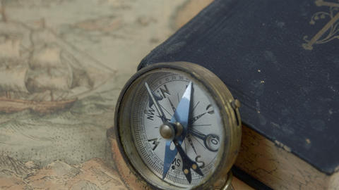Zoom out view of the compass with the book Footage