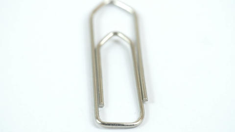 A metal paper clip on the table Stock Video Footage