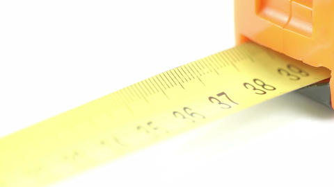 An orange tape measure with yellow numbers Stock Video Footage