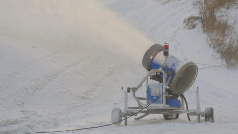 A blue snow blower on the resort Footage
