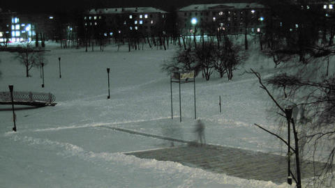man removing snow from the ice rink time lapse Stock Video Footage