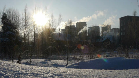 Winter landscape with smoking factory pipes timela Stock Video Footage
