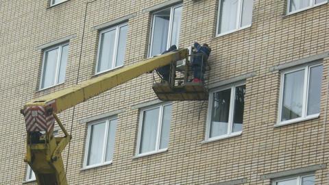 Men repairing air conditioner on derrick time laps Footage