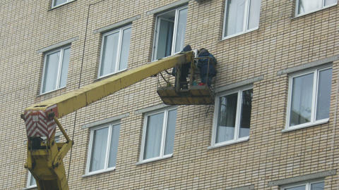 Men repairing air conditioner on derrick time laps Stock Video Footage