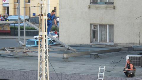 PETROZAVODSK, RUSSIA -July, 08: Men repairing elec Stock Video Footage