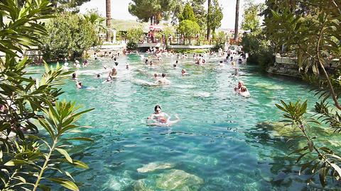 People swim in Cleopatra pools near Pamukkale, Tur Stock Video Footage