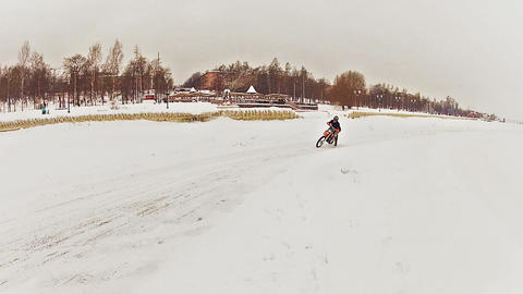 Motorcross riders training on ice Stock Video Footage