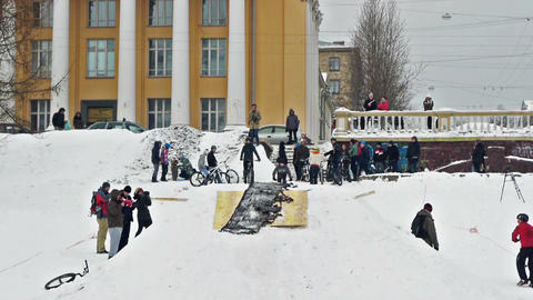 Bikers snow jumping Stock Video Footage