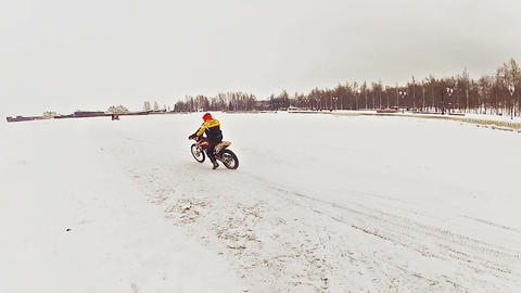 Motorcross riders training on ice Stock Video Footage