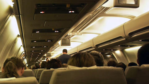 Stewardess in aircraft cabin Stock Video Footage