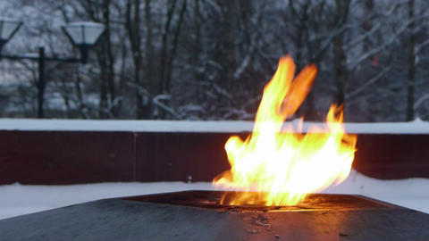 Eternal flame on the monument to unknown soldier Stock Video Footage
