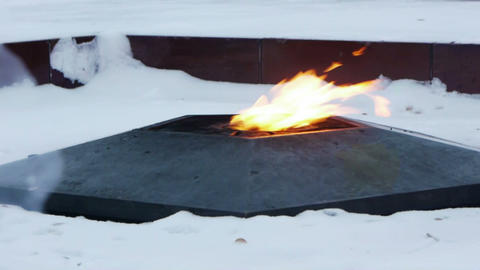 Eternal flame on the monument to unknown soldier Footage