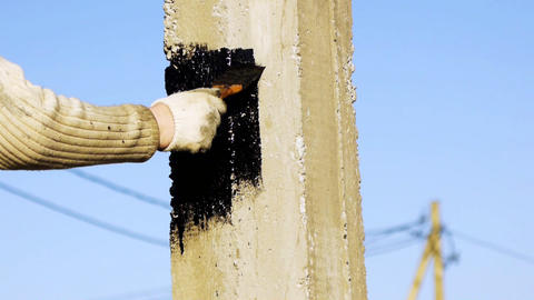 Water-proofing a pile with bitumen (tar) mastic Live Action
