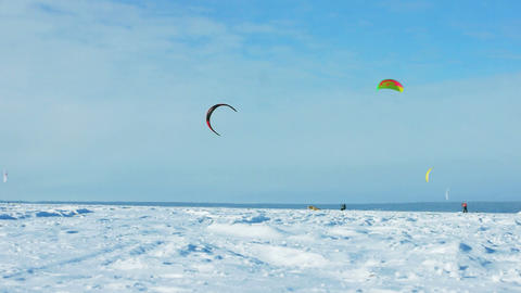 Snow-kiting on a frozen lake Stock Video Footage