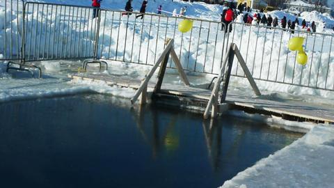 Ice-hole on a frosty lake Footage