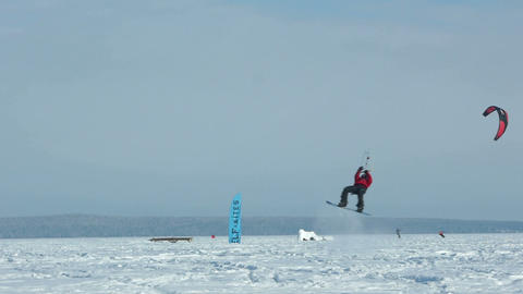Snowkiting jumping slow motion 100 fps video Stock Video Footage