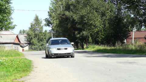 Driving a car through village Stock Video Footage