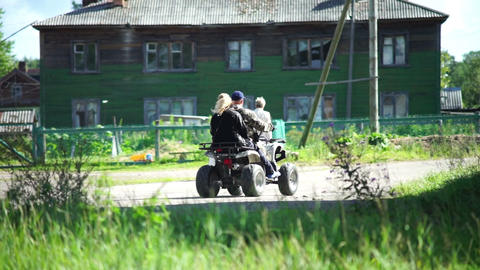 Man riding ATV bike in a village Stock Video Footage