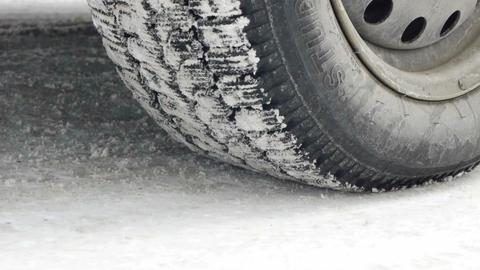 Car starts drifting wheel closeup on snowy road Footage